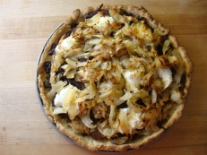 Potato Pizza with Caramelized Onions and Goat Cheese https://bigsislittledish.wordpress.com/2010/10/17/smokey-pumpkin-soup-and-potato-pizza-with-caramelized-onions-and-goat-cheese/
