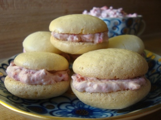 Almond Cardamom Macaroons with Raspberry Filling https://bigsislittledish.wordpress.com/2012/01/22/magical-macaroons-in-two-flavours-almond-cardamom-and-berry-or-ginger-lemon-and-white-pepper-gluten-free/