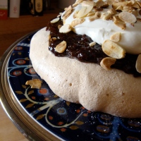 Anise Pavlova with Plum Preserves and Almond Cream