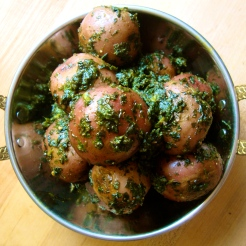 Tiny New Potatoes Smothered in Fenugreek and Butter https://bigsislittledish.wordpress.com/2012/03/10/tiny-new-potatoes-and-aromatic-greens-steamed-in-butter/