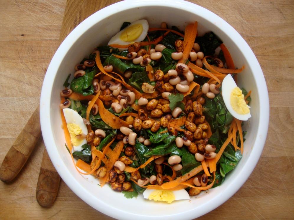 WIlted Collard Green Salad with Peanuts and Black Eyed Peas https://bigsislittledish.wordpress.com/2012/12/29/wilted-collard-green-salad-with-peanuts-and-black-eyed-peas/