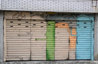 Very cuddly art on a garage door