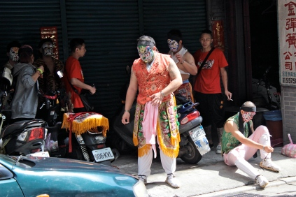 These performers were getting into costume in an alley of machine shops!