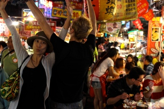 My husband, Chris, and our friend, Xiaochu, do an interpetive dance in the Night Market at Keelung!