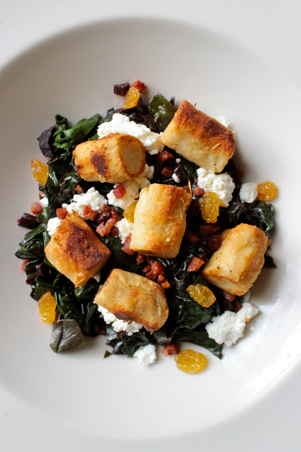 Crispy Horseradish Gnocchi with Beet Greens, Goat Cheese and Pancetta