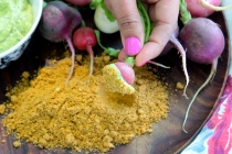 Radishes dipped in Avocado Crema and Spicy Pepita Powder